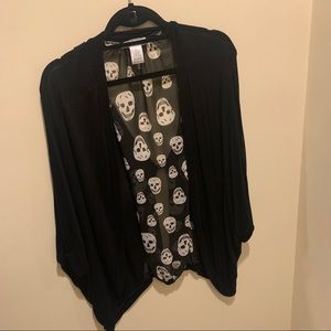 Black sweater with skull print on back